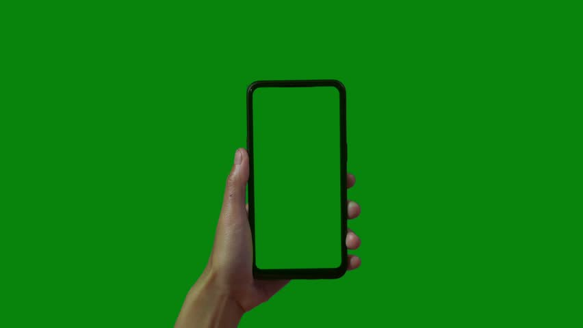 Phone in the hand close up isolated at green background. Phone screen is blue chroma key, background chroma key green screen. Footage for mobile ads, app promo. | Shutterstock HD Video #1028986919