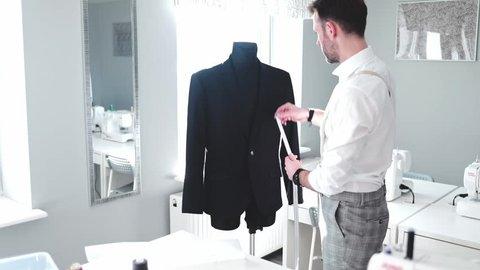 Tailor over work desk during work, fashion designer at workshop