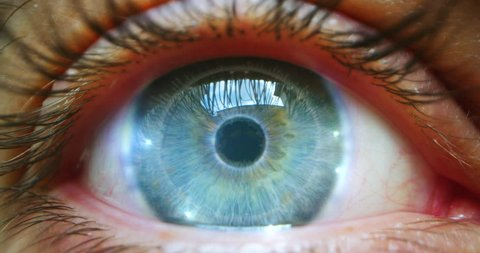 Slow motion of  young male blue eye with high technology  futuristic virtual reality for personal safety scanning.