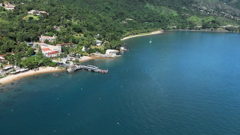 Aerial: Beachfront Resorts, Vibrant Blue Water and Jungle in Ilhabela, Brazil