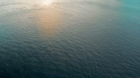 Aerial: Golden Sunset Over Archipelago and Rippling Water in Ilhabela, Brazil