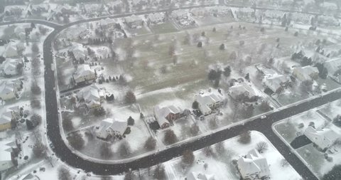 PITTSBURGH, PENNSYLVANIA, US. Aerial 4K view of the houses in winter with a blanket of snow. Winter snowy scene in North America suburbs.