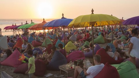 Bali, Indonesia - CIRCA 2019: Beanbags and Umbrellas La Placha Double Six Beach Seminyak - Sunset Time Lapse