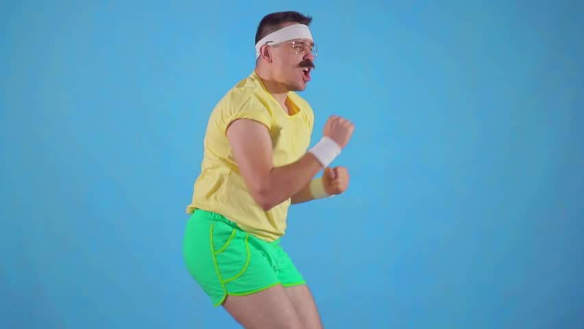 Funny man athlete from the 80's with a mustache makes the workout slow mo | Shutterstock HD Video #1029134189