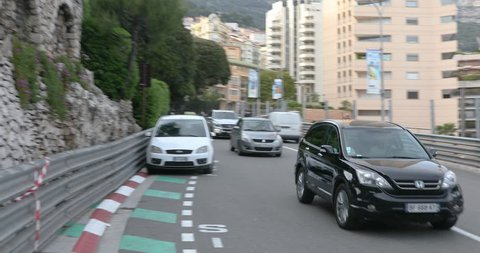 Monte Carlo, Monaco - Apr 18, 2019: Cars drive through one of the corners of the Formula One track in Monte Carlo
