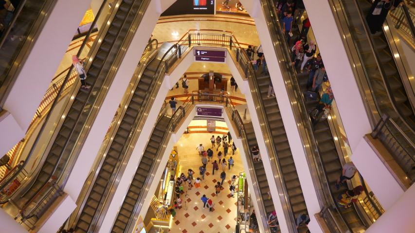 Kuala lumpur city center famous mall hall crowded escalators panorama 4k malaysia   Shutterstock HD Video #1029178109
