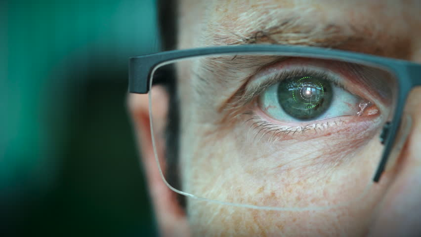 A close up of a businessman eye controlling a futuristic computer system with a Update Business concept.   Shutterstock HD Video #1029188729