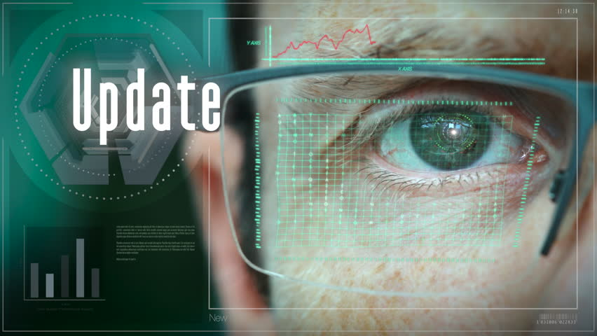 A close up of a businessman eye controlling a futuristic computer system with a Update Business concept. | Shutterstock HD Video #1029188729