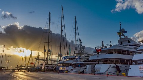 NAFPLIO,GREECE, 08 MAY 2019 : 4K Timelapse of yachts and motor boats over the blue cloudy sky in Nafplio city harbor, Greece