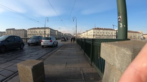 Vittorio emanuele i bridge - turin, italy the river po time warp 4k  video  taken in the year 2018, december 23, with gopro hero7 black people who are  in a hurry traffic of vehicles