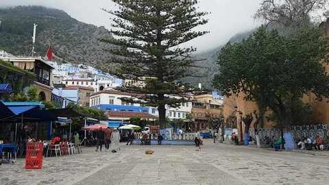 Chefchaouen, Morocco - May 4, 2019: People walking in Outa el Hammam square in Chefchouen, Morocco