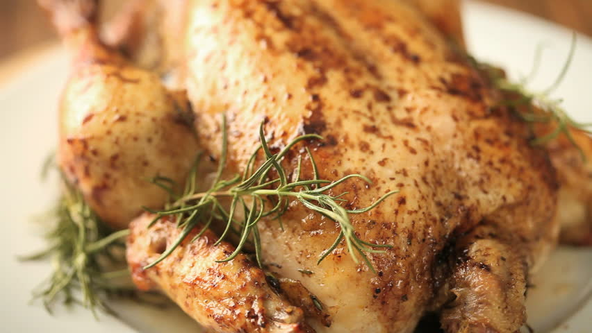 close up of roasted chicken moving from left to right
