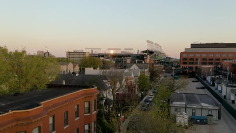 Chicago, Illinois / USA - May 13 2019: Crane Shot at Wrigley Field with the W Flag flying during sunset [4K]