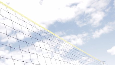 Volleyball being passed over the net during outdoor volleyball tournament
