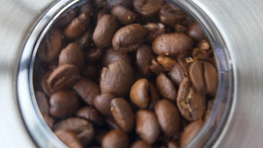 Grinding Coffee Beans in Electric Grinder Close-up Slow Motion | Shutterstock HD Video #1029565409
