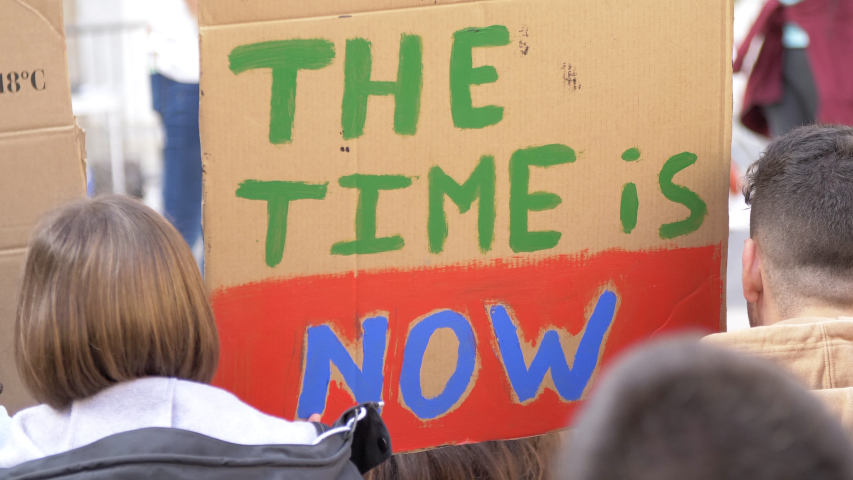 The Time is Now poster in a Meeting due Clime Change. Activists in action against the Global Warming | Shutterstock HD Video #1029607739