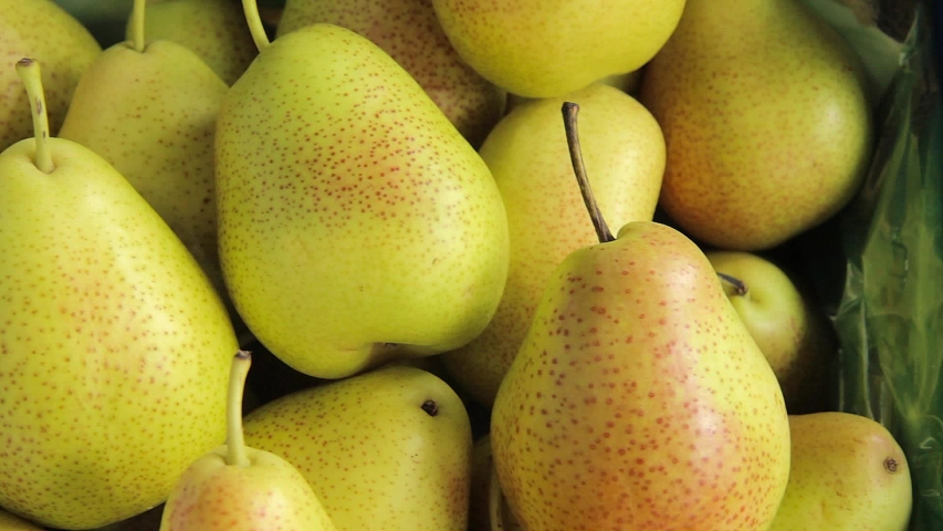 fresh ripe pears as background, top view