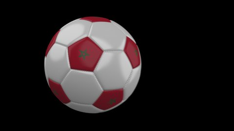 Soccer ball with flag Morocco flies past camera, slow motion blur, 4k footage with alpha channel