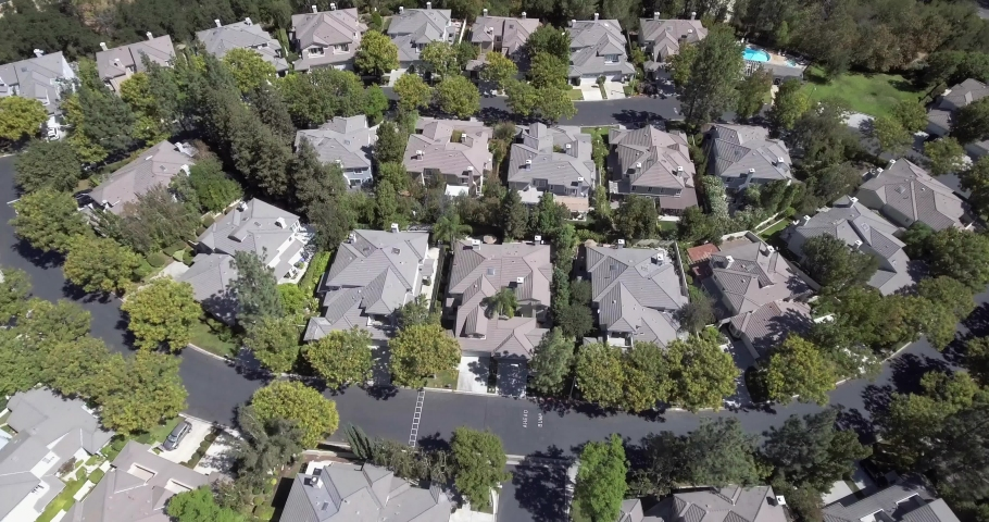 Aerial of a luxury home in a suburbia neighborhood on Los Angeles. 4k drone | Shutterstock HD Video #1029857999