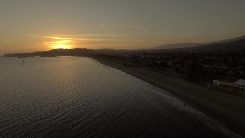 Drone flying over Santa Barbara ocean watching vibrant sunset | Shutterstock HD Video #1029895079