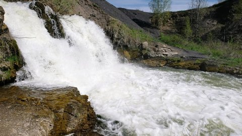 Waterfall and rocks on river Vydriha near village Belovo in Novosibirsk region, Siberia, Russia