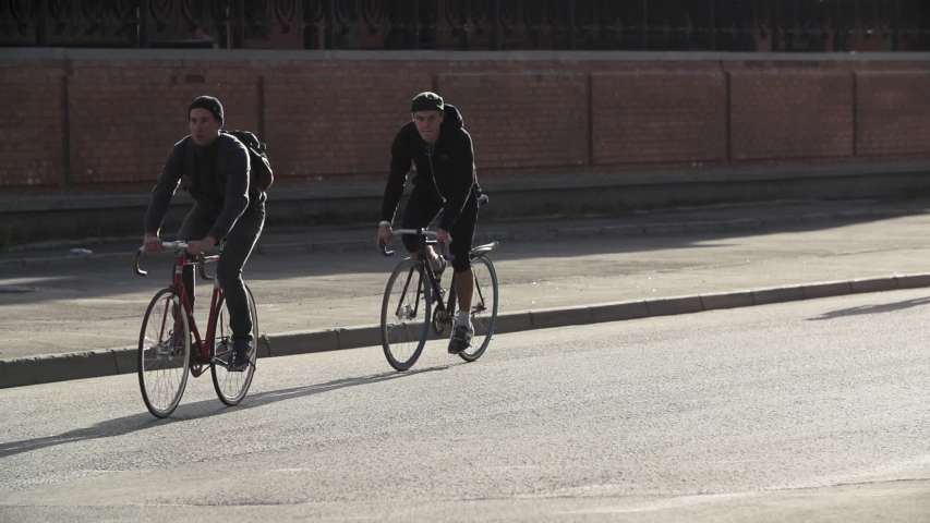 Male cyclists ride bicycles at city street. Ecological urban transport concept. Active lifestyle. Urban environment without car traffic. | Shutterstock HD Video #1029916139