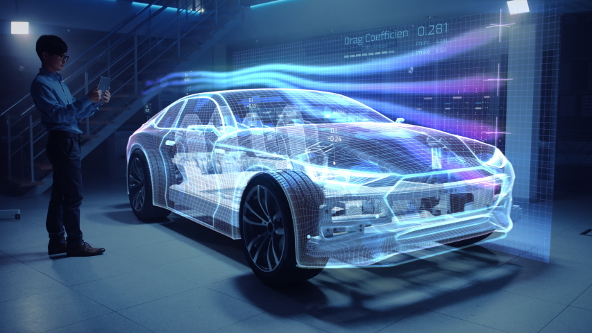 Automotive Engineer Working on Electric Car Chassis Platform, Using Tablet Computer with Augmented Reality 3D Software. Innovative Facility: Vehicle Virtual Mesh Model is Tested for Aerodynamics. | Shutterstock HD Video #1029926639