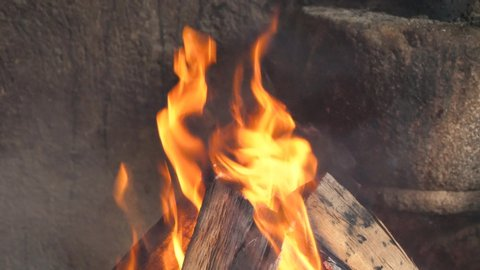 Close up footage of fire flame in fire place.