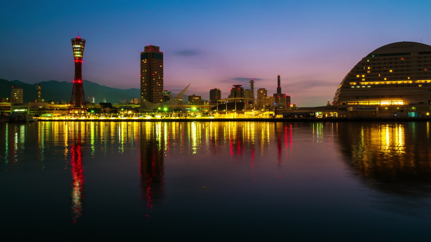 Kobe, Japan. View of sunrise in Kobe, Japan. Time-lapse of cloudless sky with harbor and numerous skyscrapers | Shutterstock HD Video #1030031939