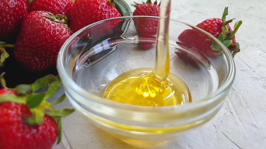 Fresh honey dripping strawberry slow motion    Shutterstock HD Video #1030099349