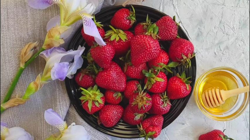 Fresh honey strawberry slow motion flower iris    Shutterstock HD Video #1030099559
