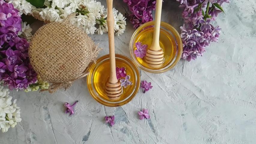 Fresh honey, lilac flower, slow motion   Shutterstock HD Video #1030099889