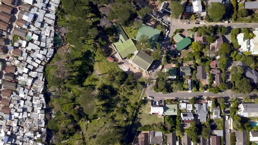 Aerial view over township and middle class houses in South Africa | Shutterstock HD Video #1030112279