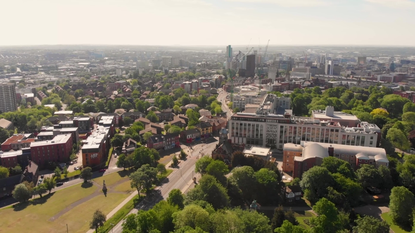 Aerial footage of the Leeds town of Headingley, the footage shows the famous Leeds University campus and the town centre in the background with roads and traffic, taken on a beautiful sunny day. | Shutterstock HD Video #1030168559