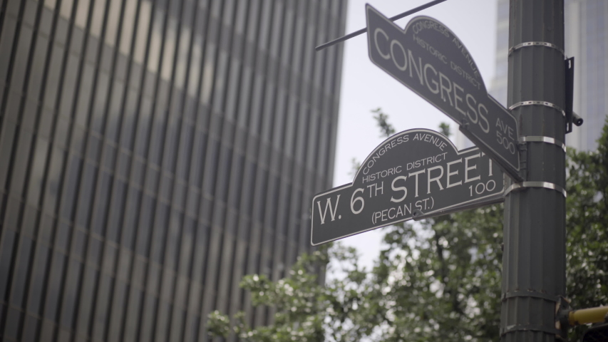 The street signs for 6th street and Congress avenue in Austin, Texas - slight camera movement | Shutterstock HD Video #1030223519