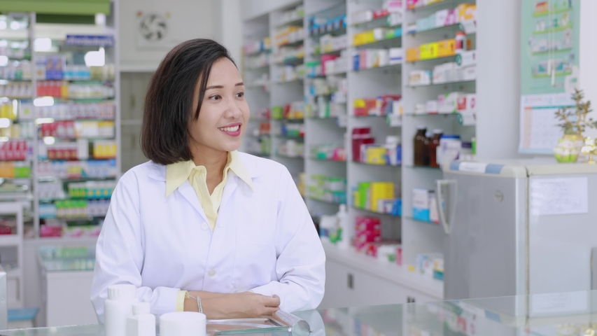 Pharmacist explained about medication to female patient in the pharmacy  | Shutterstock HD Video #1030251149