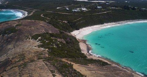 Gentle waves washing ashore on quiet Australian coastline (aerial view)