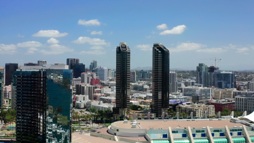 Aerial footage over the city of San Diego on a bright sunny day with blue skies. San Diego, Southern California.  | Shutterstock HD Video #1030356089
