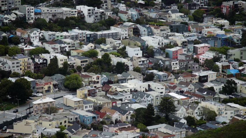 View of houses, homes, and buildings along a hill in a residential area of San Francisco. Shot on a Canon C200 in 4K in San Francisco in 2019. | Shutterstock HD Video #1030408169