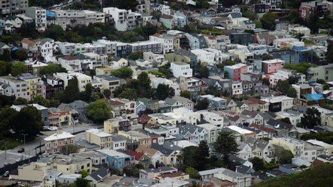 View of houses, homes, and buildings along a hill in a residential area of San Francisco. Shot on a Canon C200 in 4K in San Francisco in 2019.