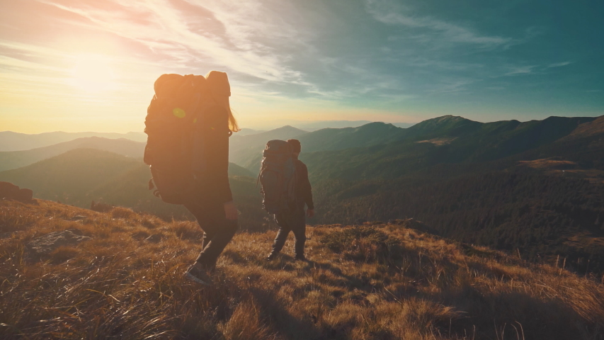 The hikers walking in the mountain on the sunrise background. slow motion | Shutterstock HD Video #1030416059