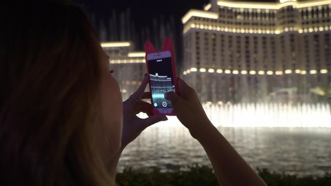Girl looking at Bellagio fountains in Las Vegas strip