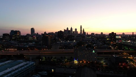 Flying up to reveal sunset over Philadelphia Skyline