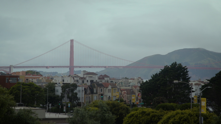View of the Golden Gate Bridge in the distant on a cloudy, foggy, dark day in San Francisco. Shot on a Canon C200 in 4K in San Francisco in 2019. | Shutterstock HD Video #1030690289