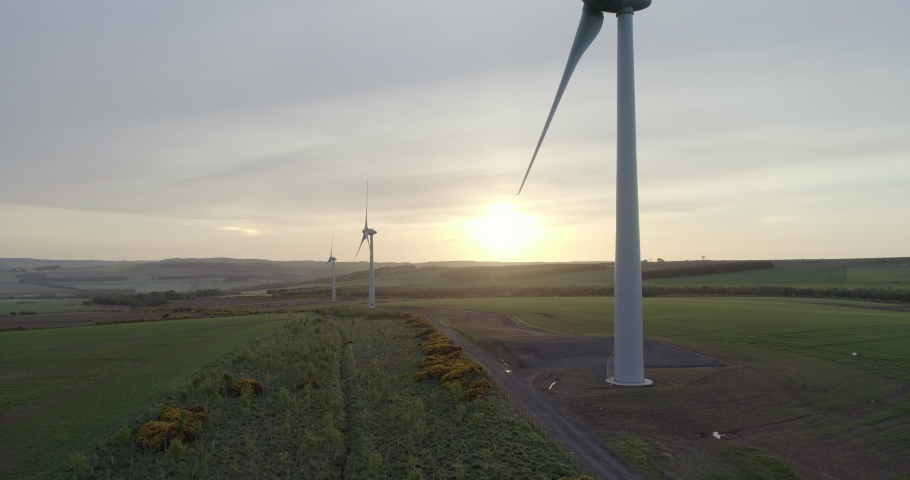 Aerial footage of the a wind turbine farm in Scotland | Shutterstock HD Video #1030725479