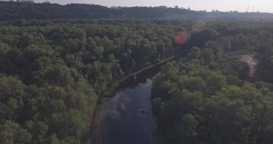 Beautiful landscape in the golden hour of sunset. Aerial view of the Dnieper River, the river runs through the city of Kiev / Ukraine. Filmed from 4K drone in RAW. Video for post-processing.