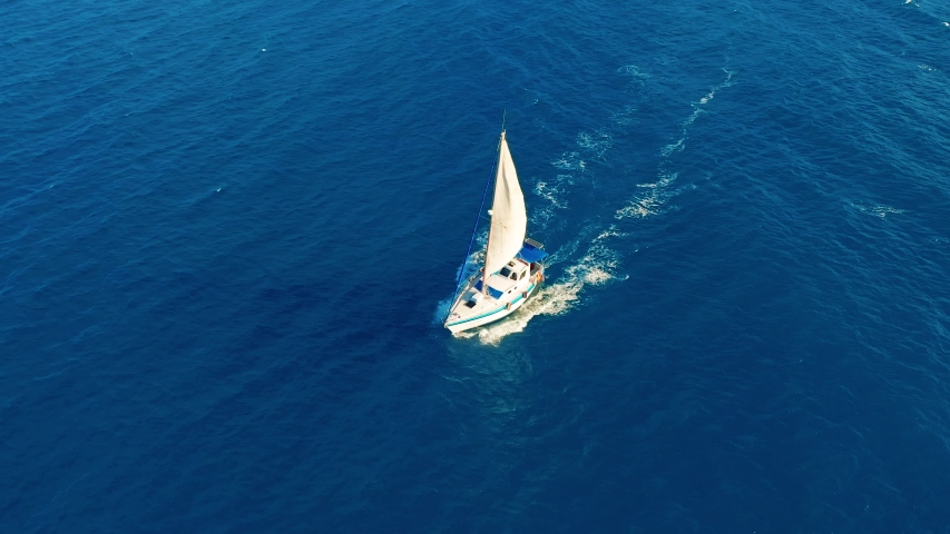 Aerial view. Yacht sailing on open sea at sunny day. Sailing boat. | Shutterstock HD Video #1030833929
