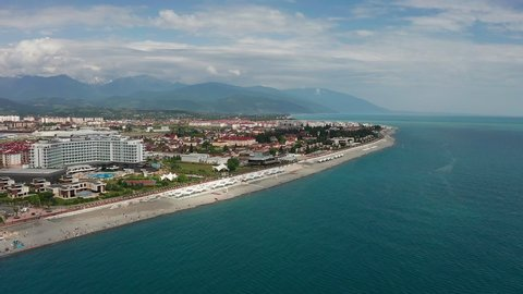 Aerial video shooting. Panoramic view of Imeretinsky resort. black sea in Sochi. Clean and comfortable beach.  Recreation area. Caucasus mountain. The view from the top. Tourist season. Luxury hotel.