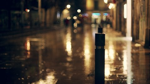 Rainy night in Barcelona. Wet medieval  streets of european city in the spring. Water drops on bicycle wheels and  steering wheel. Beautifil background. Lights and colour, reflectionshadows and bokeh.