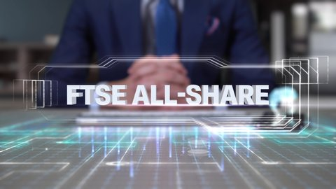 Businessman Writing on Hologram Desk Tech Word- FTSE ALL-SHARE